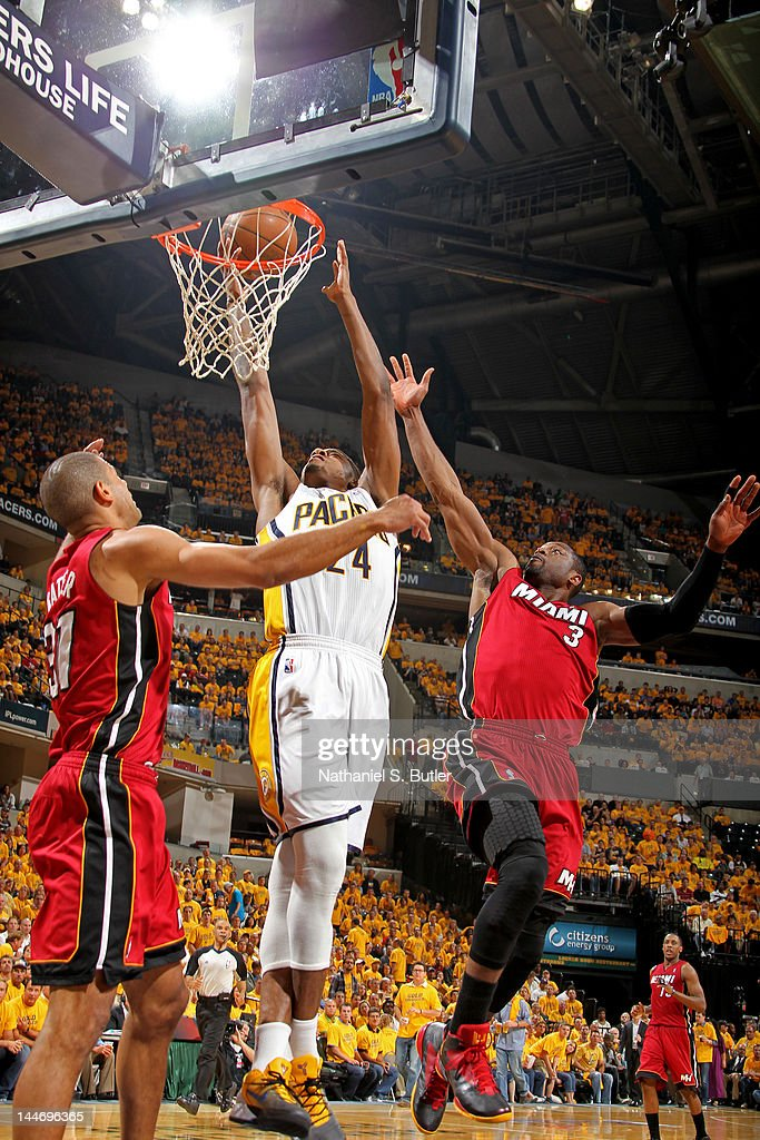 Paul George #24 of the Indiana Pacers goes to the basket against Dwyane Wade #3 of the Miami Heat in Game Three of the Eastern Conference Semifinals during the 2012 NBA Playoffs on May 17, 2012 at Bankers Life Fieldhouse in Indianapolis, Indiana.