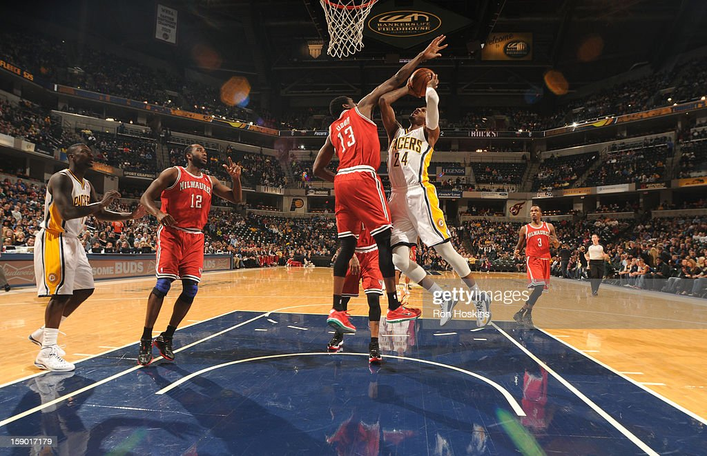 Paul George #24 of the Indiana Pacers goes to the basket against <a gi-track='captionPersonalityLinkClicked' href=/galleries/search?phrase=Ekpe+Udoh&family=editorial&specificpeople=4185351 ng-click='$event.stopPropagation()'>Ekpe Udoh</a> #13 of the Milwaukee Bucks during the game between the Milwaukee Bucks and the Indiana Pacers on January 5, 2013 at Bankers Life Fieldhouse in Indianapolis, Indiana.