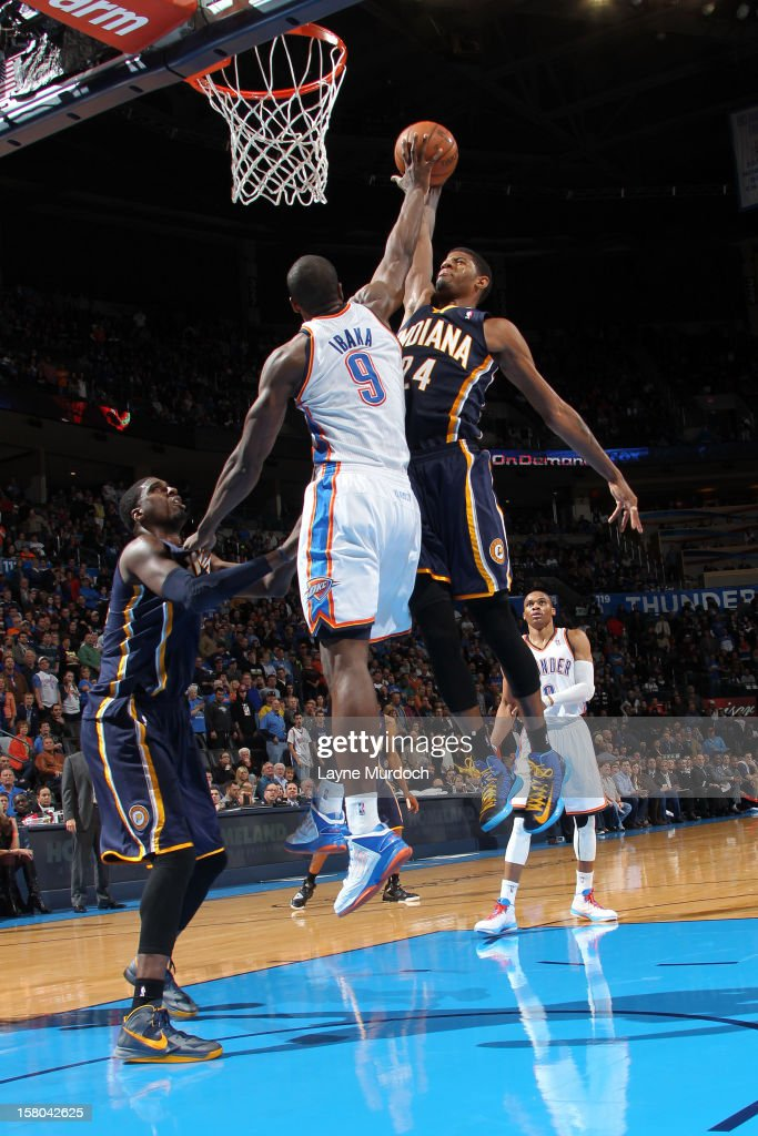 Paul George #24 of the Indiana Pacers goes to the basket against <a gi-track='captionPersonalityLinkClicked' href=/galleries/search?phrase=Serge+Ibaka&family=editorial&specificpeople=5133378 ng-click='$event.stopPropagation()'>Serge Ibaka</a> #9 of the Oklahoma City Thunder during the game between the Oklahoma City Thunder and the Indiana Pacers on December 9, 2012 at the Chesapeake Energy Arena in Oklahoma City, Oklahoma.