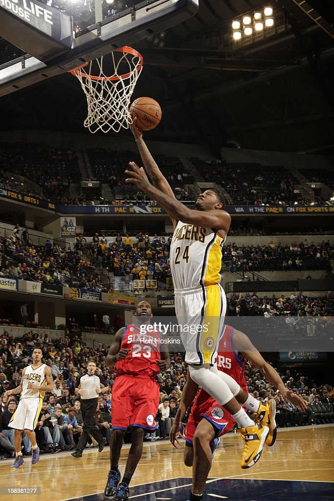 Paul George #24 of the Indiana Pacers goes to the basket against the Philadelphia 76ers on December 14, 2012 at Bankers Life Fieldhouse in Indianapolis, Indiana.