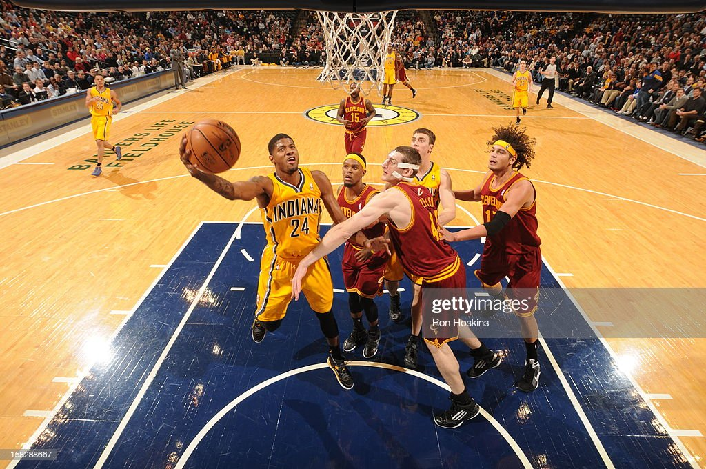 Paul George #24 of the Indiana Pacers goes to the basket against <a gi-track='captionPersonalityLinkClicked' href=/galleries/search?phrase=Tyler+Zeller&family=editorial&specificpeople=5122156 ng-click='$event.stopPropagation()'>Tyler Zeller</a> #40 of the Cleveland Cavaliers during the game between the Indiana Pacers and the Cleveland Cavaliers on December 12, 2012 at Bankers Life Fieldhouse in Indianapolis, Indiana.