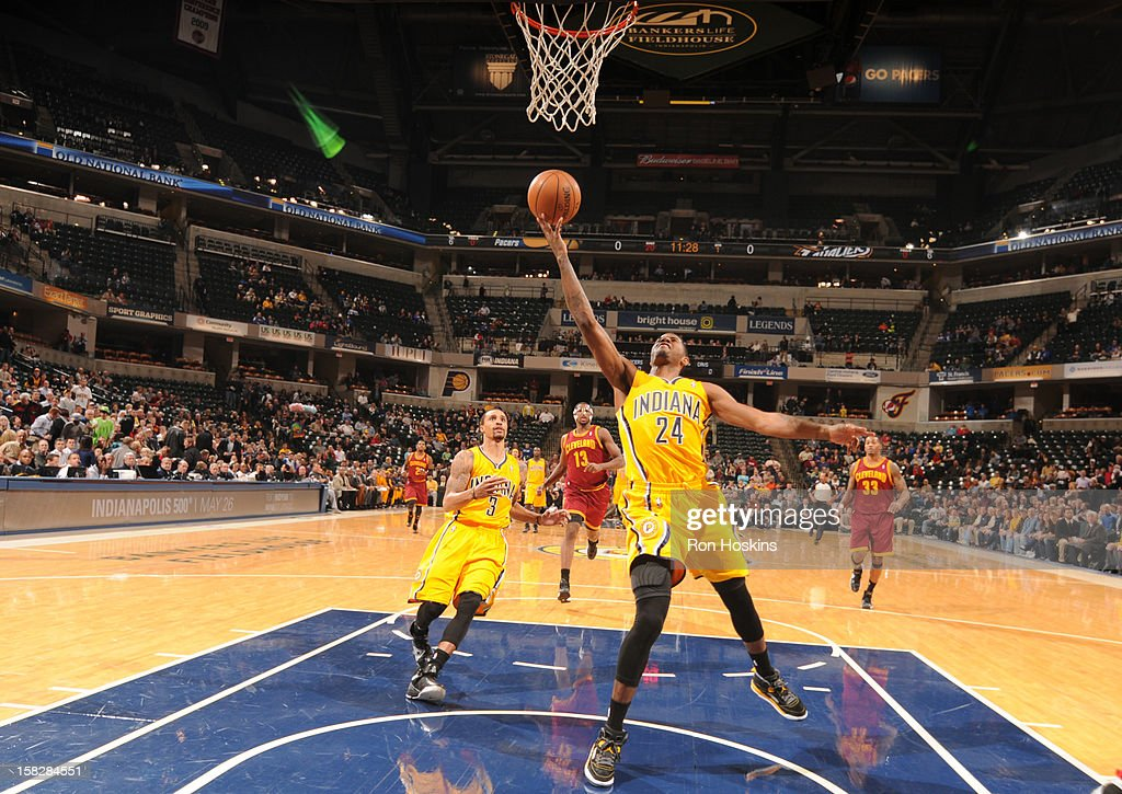 Paul George #24 of the Indiana Pacers goes to the basket during the game between the Indiana Pacers and the Cleveland Cavaliers on December 12, 2012 at Bankers Life Fieldhouse in Indianapolis, Indiana.