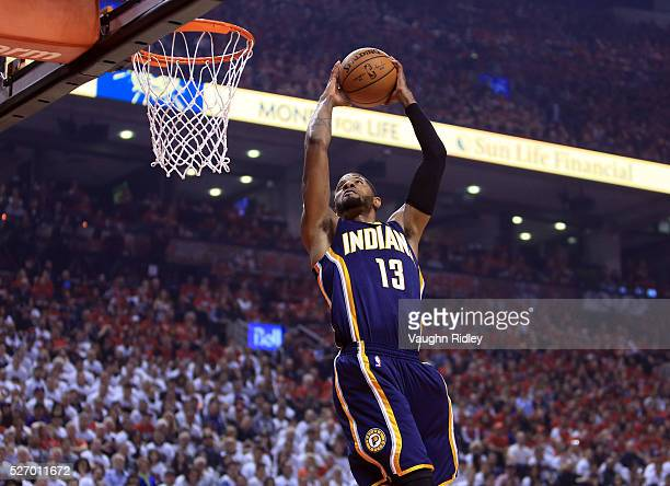 Paul George of the Indiana Pacers goes up for a dunk in the first half of Game Seven of the Eastern Conference Quarterfinals against the Toronto...