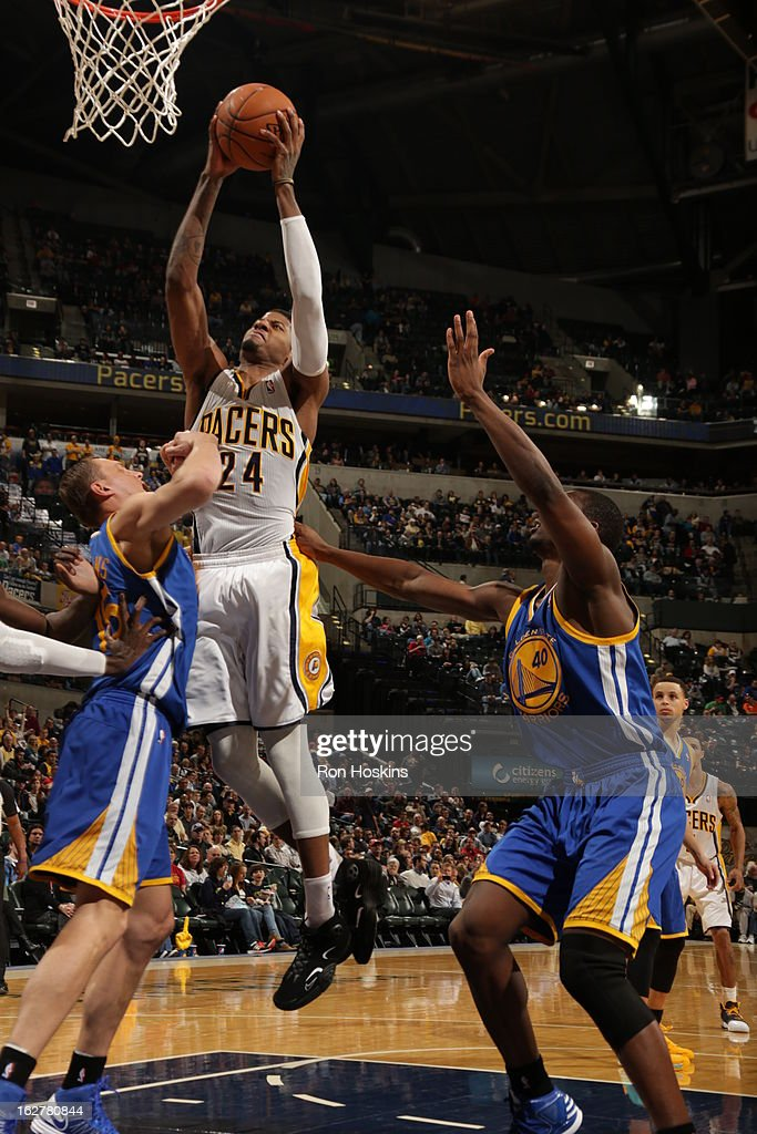 Paul George #24 of the Indiana Pacers goes up for the slamdunnk against the Golden State Warriors on February 26, 2013 at Bankers Life Fieldhouse in Indianapolis, Indiana.