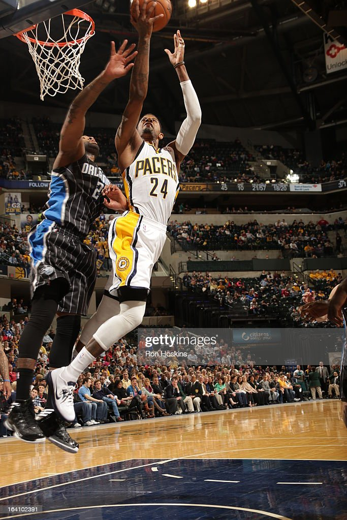 Paul George #24 of the Indiana Pacers goes up strong to the basket against <a gi-track='captionPersonalityLinkClicked' href=/galleries/search?phrase=Kyle+O%27Quinn&family=editorial&specificpeople=9027719 ng-click='$event.stopPropagation()'>Kyle O'Quinn</a> #2 of the Orlando Magic on March 19, 2013 at Bankers Life Fieldhouse in Indianapolis, Indiana.