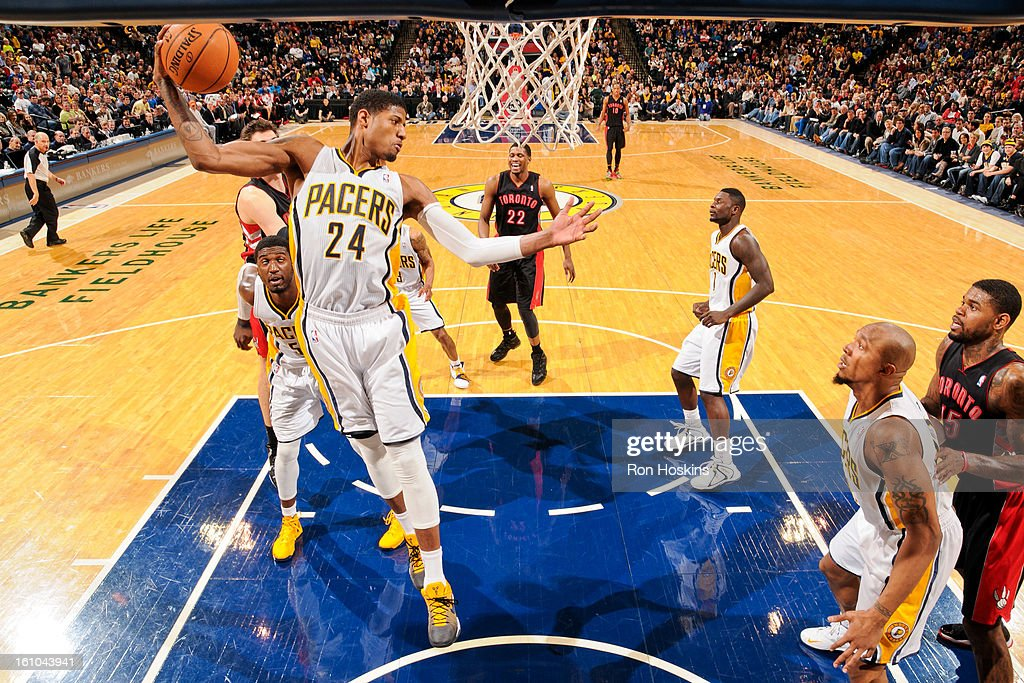 Paul George #24 of the Indiana Pacers grabs a rebound against the Toronto Raptors on February 8, 2013 at Bankers Life Fieldhouse in Indianapolis, Indiana.