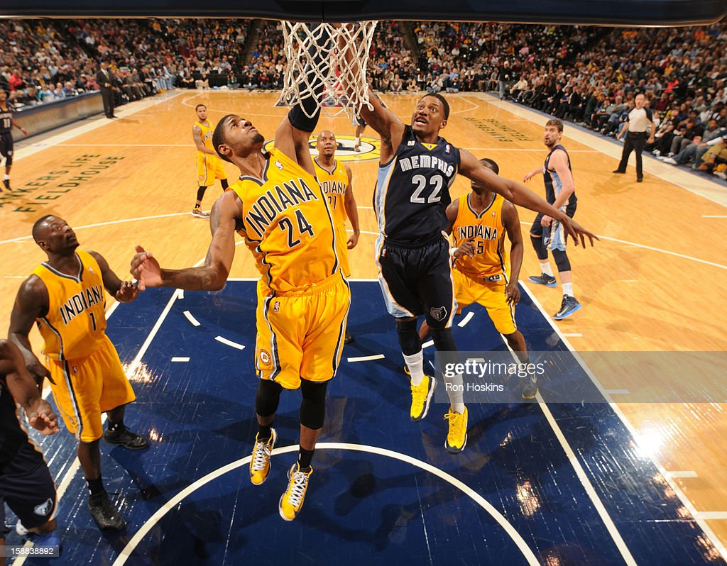Paul George #24 of the Indiana Pacers grabs a rebound over <a gi-track='captionPersonalityLinkClicked' href=/galleries/search?phrase=Rudy+Gay&family=editorial&specificpeople=236066 ng-click='$event.stopPropagation()'>Rudy Gay</a> #22 of the Memphis Grizzlies on December 31, 2012 at Bankers Life Fieldhouse in Indianapolis, Indiana.