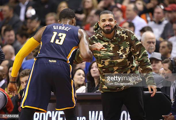 Paul George of the Indiana Pacers greets recording artist Drake against the Toronto Raptors in Game One of the Eastern Conference Quarterfinals...