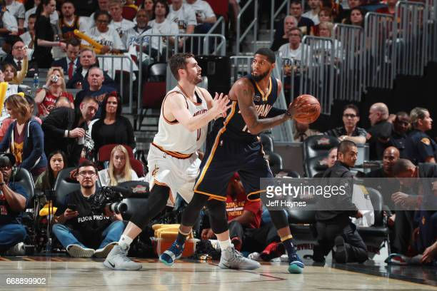Paul George of the Indiana Pacers handles the ball against Kevin Love of the Cleveland Cavaliers during a game in Round One of the Eastern Conference...
