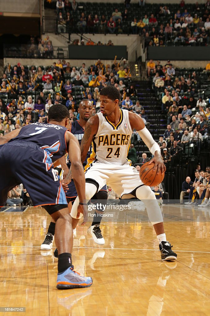 Paul George #24 of the Indiana Pacers handles the ball against Ramon Sessions #7 of the Charlotte Bobcats on February 13, 2013 at Bankers Life Fieldhouse in Indianapolis, Indiana.