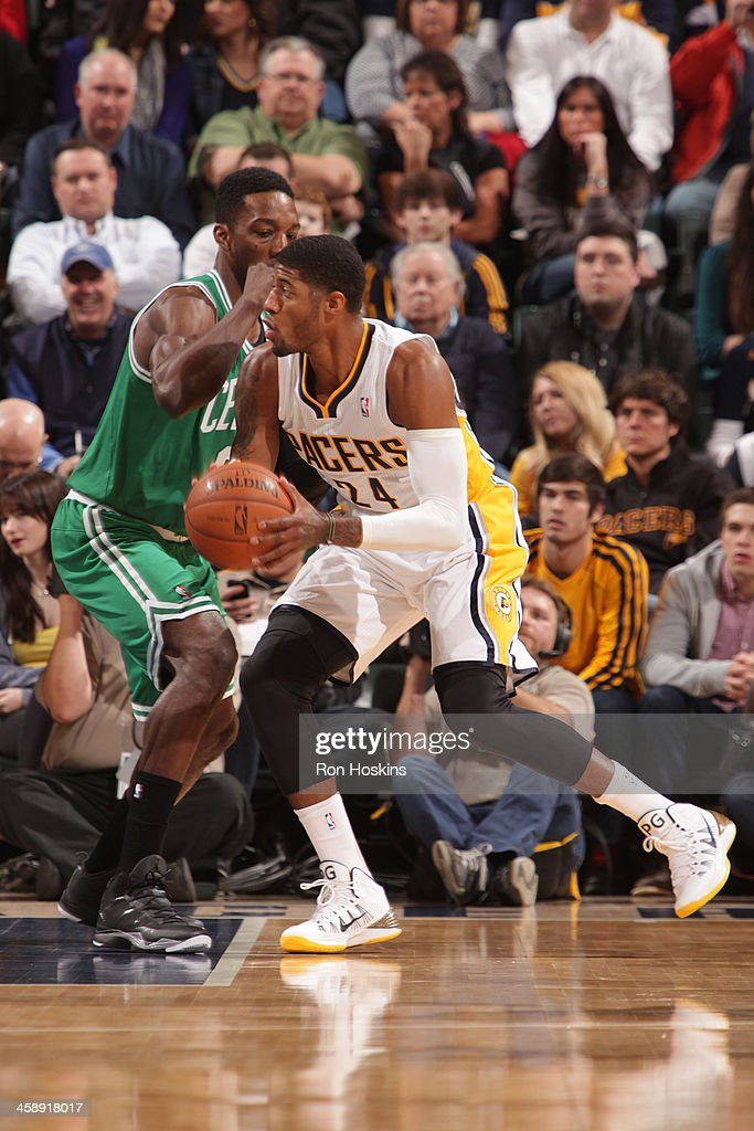 Paul George #24 of the Indiana Pacers handles the ball against the Boston Celtics at Bankers Life Fieldhouse on December 22, 2013 in Indianapolis, Indiana.