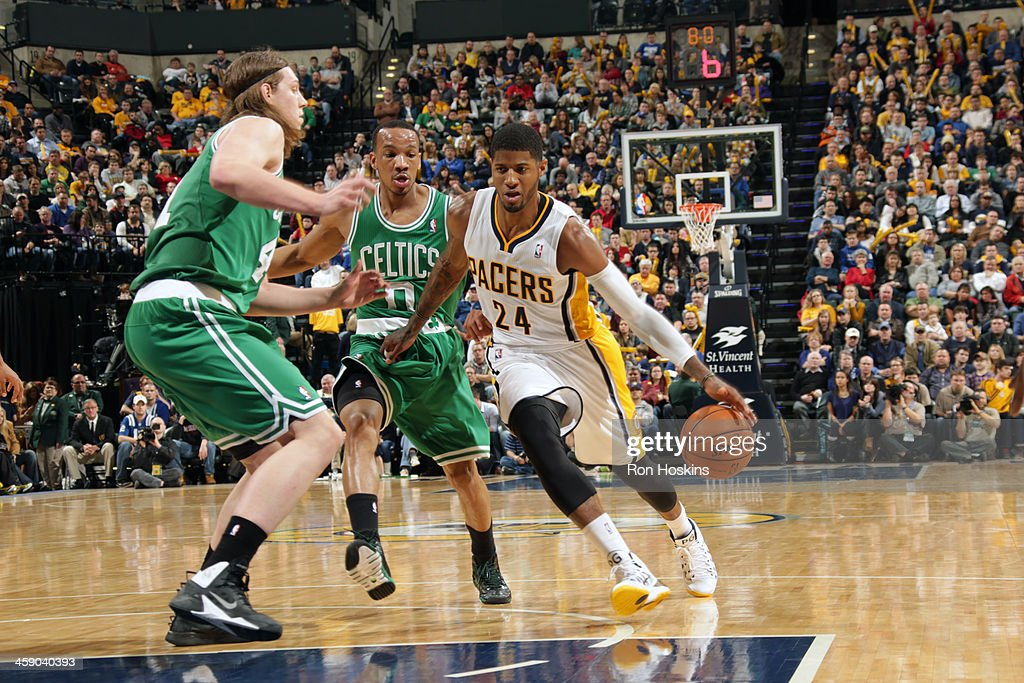 Paul George #24 of the Indiana Pacers handles the ball against the Boston Celtics on December 22, 2013 in Indianapolis, Indiana at Bankers Life Fieldhouse.