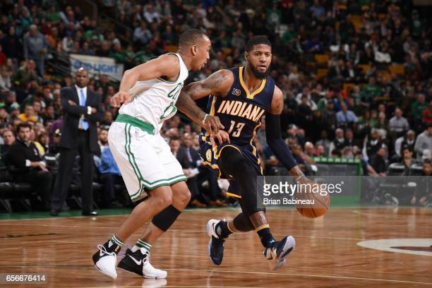 Paul George of the Indiana Pacers handles the ball against the Boston Celtics during the game on March 22 2017 at the TD Garden in Boston...