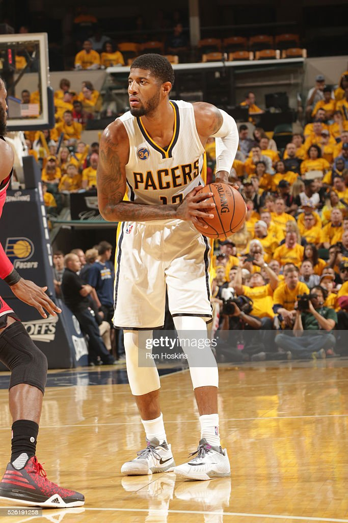 <a gi-track='captionPersonalityLinkClicked' href=/galleries/search?phrase=Paul+George+-+Basketballer&family=editorial&specificpeople=7235030 ng-click='$event.stopPropagation()'>Paul George</a> #13 of the Indiana Pacers handles the ball against the Toronto Raptors in Game Six of the Eastern Conference Quarterfinals during the 2016 NBA Playoffs on April 29, 2016 at Bankers Life Fieldhouse in Indianapolis, Indiana.