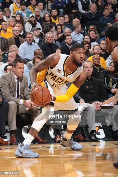 Paul George of the Indiana Pacers handles the ball during a game against the Charlotte Hornets on March 15 2017 at Bankers Life Fieldhouse in...