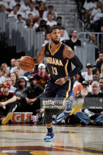 Paul George of the Indiana Pacers handles the ball during a game against the Cleveland Cavaliers in Round One of the Eastern Conference Playoffs...