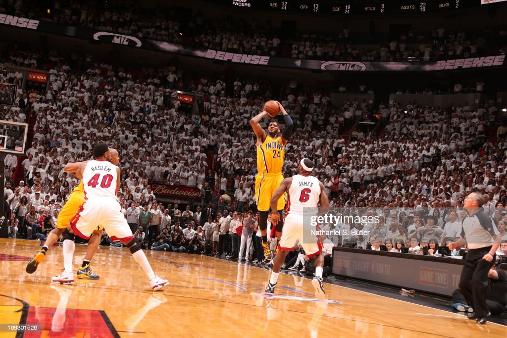 Paul George #24 of the Indiana Pacers hits a three against LeBron James #6 of the Miami Heat to tie the game and force overtime in Game One of the Eastern Conference Finals on May 22, 2013 at American Airlines Arena in Miami, Florida.