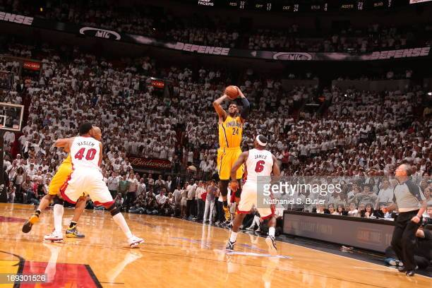Paul George of the Indiana Pacers hits a three against LeBron James of the Miami Heat to tie the game and force overtime in Game One of the Eastern...
