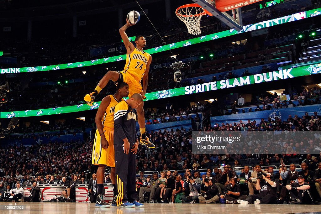 Paul George of the Indiana Pacers jumps over pacers teammates <a gi-track='captionPersonalityLinkClicked' href=/galleries/search?phrase=Roy+Hibbert&family=editorial&specificpeople=725128 ng-click='$event.stopPropagation()'>Roy Hibbert</a> and <a gi-track='captionPersonalityLinkClicked' href=/galleries/search?phrase=Dahntay+Jones&family=editorial&specificpeople=202206 ng-click='$event.stopPropagation()'>Dahntay Jones</a> as he dunks during the Sprite Slam Dunk Contest part of 2012 NBA All-Star Weekend at Amway Center on February 25, 2012 in Orlando, Florida.