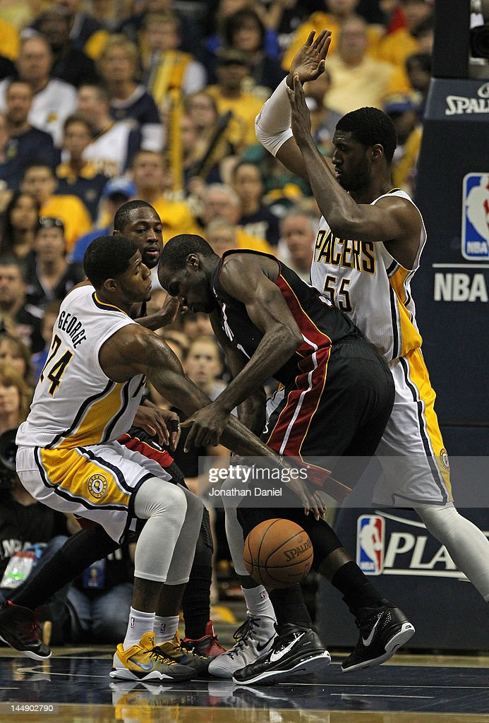 Paul George #24 of the Indiana Pacers knocks the ball away from <a gi-track='captionPersonalityLinkClicked' href=/galleries/search?phrase=Joel+Anthony&family=editorial&specificpeople=4092295 ng-click='$event.stopPropagation()'>Joel Anthony</a> #50 of the Miami Heat as <a gi-track='captionPersonalityLinkClicked' href=/galleries/search?phrase=Roy+Hibbert&family=editorial&specificpeople=725128 ng-click='$event.stopPropagation()'>Roy Hibbert</a> #55 defends in Game Four of the Eastern Conference Semifinals in the 2012 NBA Playoffs at Bankers Life Fieldhouse on May 20, 2012 in Indianapolis, Indiana.