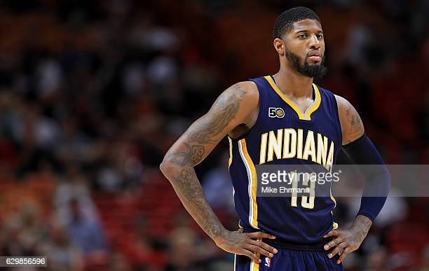Paul George of the Indiana Pacers looks on during a game against the Miami Heat at American Airlines Arena on December 14 2016 in Miami Florida NOTE...