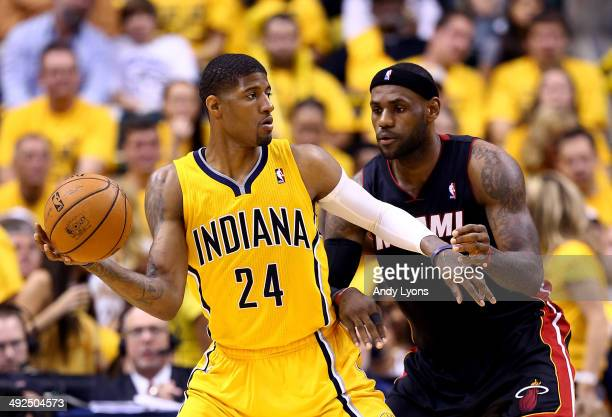 Paul George of the Indiana Pacers looks to pass as LeBron James of the Miami Heat defends during Game Two of the Eastern Conference Finals of the...