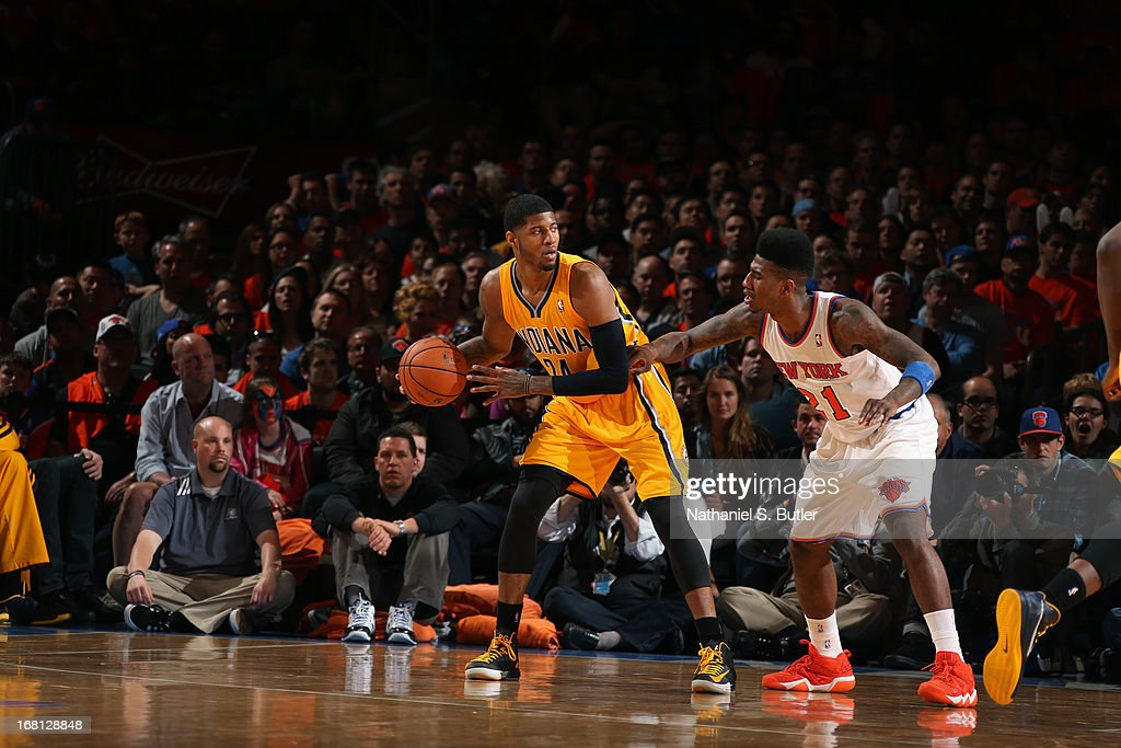 Paul George #24 of the Indiana Pacers looks to pass the ball against <a gi-track='captionPersonalityLinkClicked' href=/galleries/search?phrase=Iman+Shumpert&family=editorial&specificpeople=5042486 ng-click='$event.stopPropagation()'>Iman Shumpert</a> #21 of the New York Knicks in Game One of the Eastern Conference Semifinals during the 2013 NBA Playoffs on May 5, 2013 at Madison Square Garden in New York City.