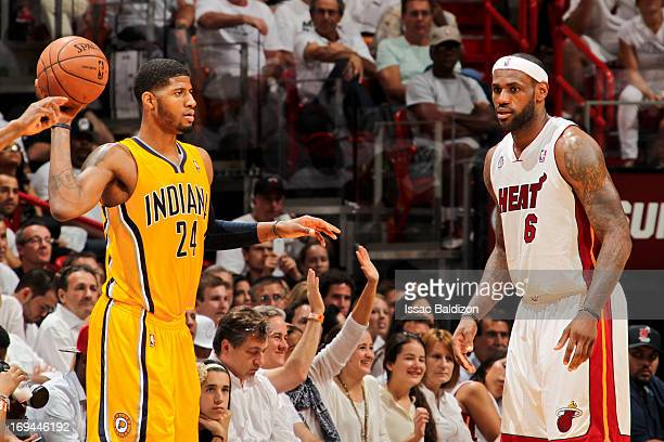 Paul George of the Indiana Pacers looks to pass the ball against LeBron James of the Miami Heat in Game Two of the Eastern Conference Finals during...