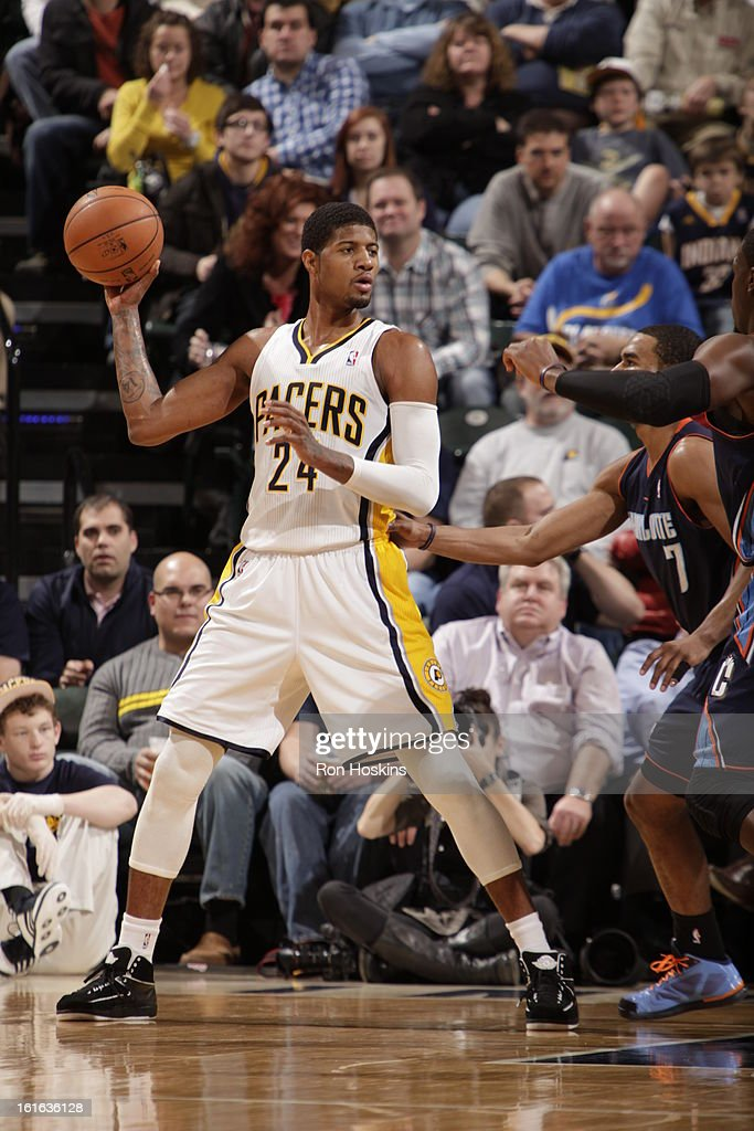 Paul George #24 of the Indiana Pacers looks to pass the ball against the Charlotte Bobcats on February 13, 2013 at Bankers Life Fieldhouse in Indianapolis, Indiana.