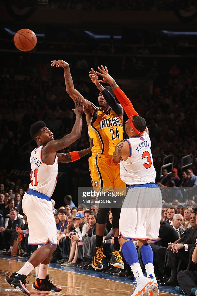 Paul George #24 of the Indiana Pacers makes a pass against Iman Shumpert #21 and Kenyon Martin #3 of the New York Knicks in Game Two of the Eastern Conference Semifinals during the 2013 NBA Playoffs on May 7, 2013 at Madison Square Garden in New York City.