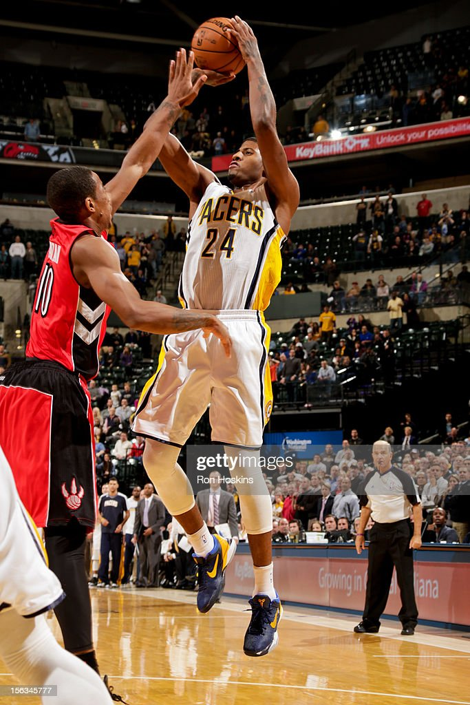 Paul George #24 of the Indiana Pacers misses a game-tying shot as time runs out on the clock against DeMar DeRozan #10 of the Toronto Raptors on November 13, 2012 at Bankers Life Fieldhouse in Indianapolis, Indiana.