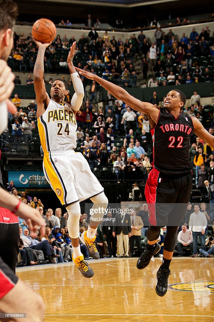 Paul George #24 of the Indiana Pacers misses a game-tying shot in overtime against <a gi-track='captionPersonalityLinkClicked' href=/galleries/search?phrase=Rudy+Gay&family=editorial&specificpeople=236066 ng-click='$event.stopPropagation()'>Rudy Gay</a> #22 of the Toronto Raptors on February 8, 2013 at Bankers Life Fieldhouse in Indianapolis, Indiana.