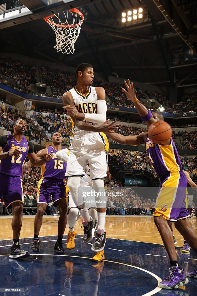 Paul George #24 of the Indiana Pacers passes the ball against the Los Angeles Lakers on March 15, 2013 at Bankers Life Fieldhouse in Indianapolis, Indiana.