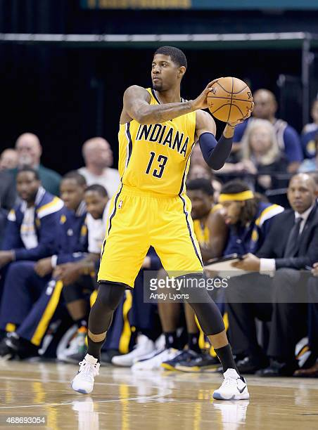 Paul George of the Indiana Pacers practices looks to pass the ball against the Miami Heat at Bankers Life Fieldhouse on April 5 2015 in Indianapolis...