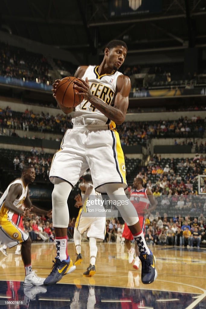 Paul George #24 of the Indiana Pacers protects the ball during the game between the Indiana Pacers and the Washington Wizards on November 10, 2012 at Bankers Life Fieldhouse in Indianapolis, Indiana.