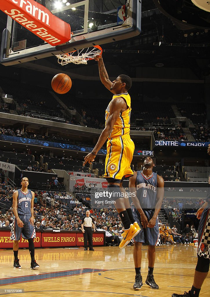 Paul George #24 of the Indiana Pacers puts down a dunk against the Charlotte Bobcats on March 23, 2011 at Time Warner Cable Arena in Charlotte, North Carolina.
