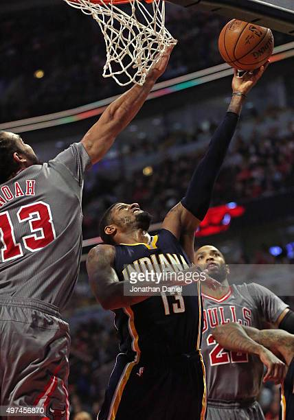 Paul George of the Indiana Pacers puts up a shot between Pau Gasol and Taj Gibson of the Chicago Bulls on his way to a gamehigh 26 points at the...