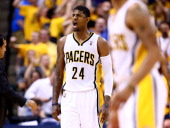 Paul George of the Indiana Pacers reacts against the Miami Heat during Game Five of the Eastern Conference Finals of the 2014 NBA Playoffs at Bankers...