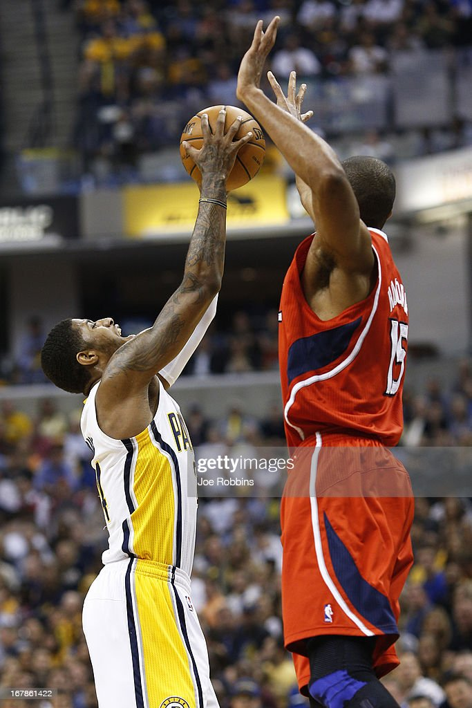 Paul George #24 of the Indiana Pacers rebounds against Al Horford #15 of the Atlanta Hawks during the first quarter of Game Five of the Eastern Conference first round of the 2013 NBA Playoffs at Bankers Life Fieldhouse on May 1, 2013 in Indianapolis, Indiana.