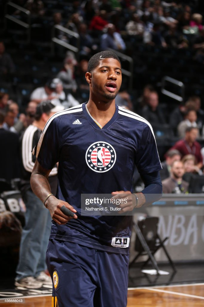 Paul George #24 of the Indiana Pacers runs around the court warming up before playing against the game warms up before playing against the Brooklyn Nets during a game at Barclays Center on November 9, 2013 in the Brooklyn borough of New York City.