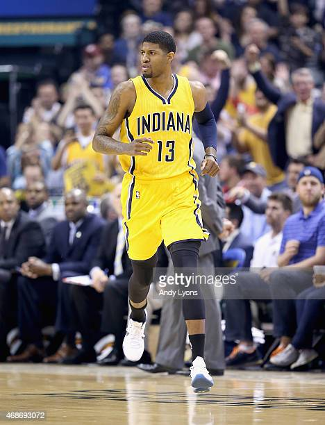 Paul George of the Indiana Pacers runs down the court against the Miami Heat at Bankers Life Fieldhouse on April 5 2015 in Indianapolis Indiana...