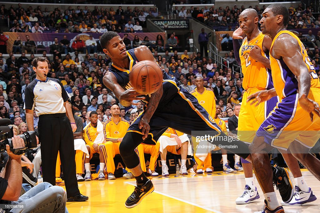 Paul George #24 of the Indiana Pacers saves the ball from going out against the Los Angeles Lakers at Staples Center on November 27, 2012 in Los Angeles, California.