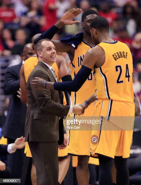 Paul George of the Indiana Pacers shakes hands with head coach Frank Vogel during the closing seconds of the Pacers 8563 win over the Washington...
