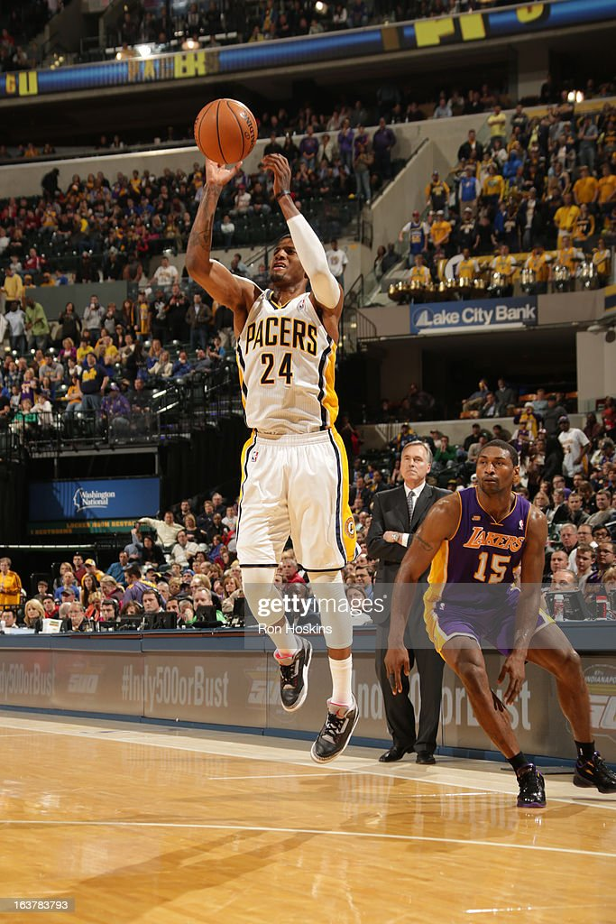 Paul George #24 of the Indiana Pacers shoots a jumper against Metta World Peace #15 of the Los Angeles Lakers on March 15, 2013 at Bankers Life Fieldhouse in Indianapolis, Indiana.