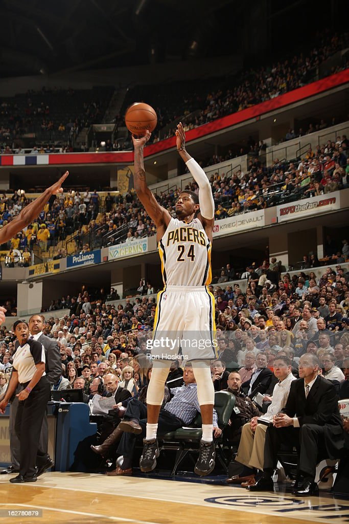 Paul George #24 of the Indiana Pacers shoots a three pointer against the Golden State Warriors on February 26, 2013 at Bankers Life Fieldhouse in Indianapolis, Indiana.