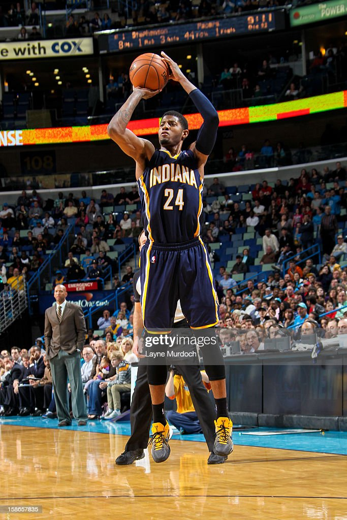Paul George #24 of the Indiana Pacers shoots a three-pointer against the New Orleans Hornets on December 22, 2012 at the New Orleans Arena in New Orleans, Louisiana.