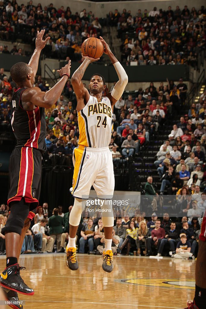 Paul George #24 of the Indiana Pacers shoots against <a gi-track='captionPersonalityLinkClicked' href=/galleries/search?phrase=Chris+Bosh&family=editorial&specificpeople=201574 ng-click='$event.stopPropagation()'>Chris Bosh</a> #1 of the Miami Heat on January 8, 2013 at Bankers Life Fieldhouse in Indianapolis, Indiana.