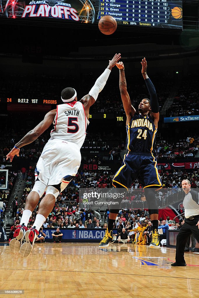 Paul George #24 of the Indiana Pacers shoots against <a gi-track='captionPersonalityLinkClicked' href=/galleries/search?phrase=Josh+Smith+-+Joueur+de+basketball+-+N%C3%A9+en+1985&family=editorial&specificpeople=201983 ng-click='$event.stopPropagation()'>Josh Smith</a> #5 of the Atlanta Hawks in Game Three of the Eastern Conference Quarterfinals in the 2013 NBA Playoffs on April 27, 2013 at Philips Arena in Atlanta, Georgia.