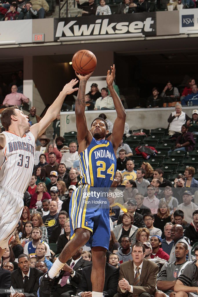 Paul George #24 of the Indiana Pacers shoots against <a gi-track='captionPersonalityLinkClicked' href=/galleries/search?phrase=Matt+Carroll+-+Joueur+de+basketball&family=editorial&specificpeople=213200 ng-click='$event.stopPropagation()'>Matt Carroll</a> #33 of the Charlotte Bobcats on February 19, 2012 at Bankers Life Fieldhouse in Indianapolis, Indiana.