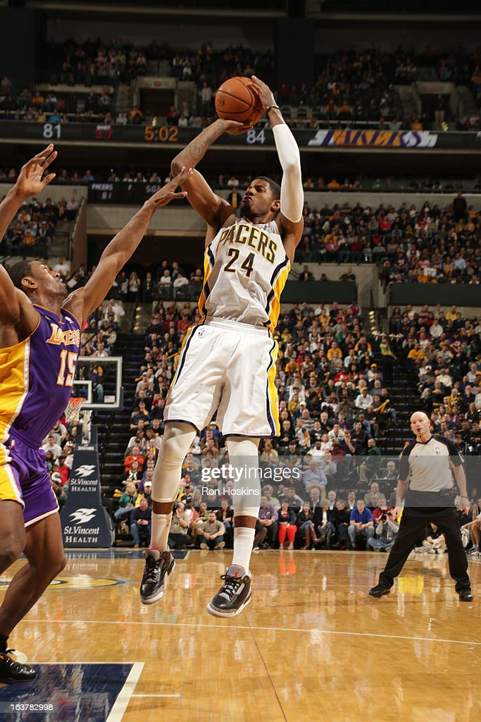 Paul George #24 of the Indiana Pacers shoots against Metta World Peace #15 of the Los Angeles Lakers on March 15, 2013 at Bankers Life Fieldhouse in Indianapolis, Indiana.